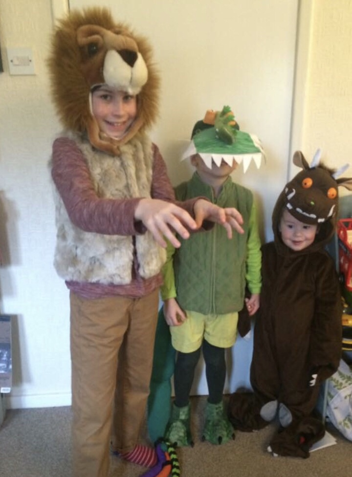 World Book day love it or hate it? Three kids dressed up as a lion, crocodile and a grufallo