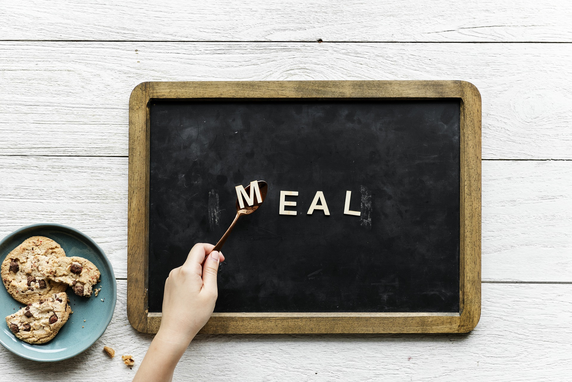 February meal plan ideas board with the word meal spelt out on a chalkboard and a fork