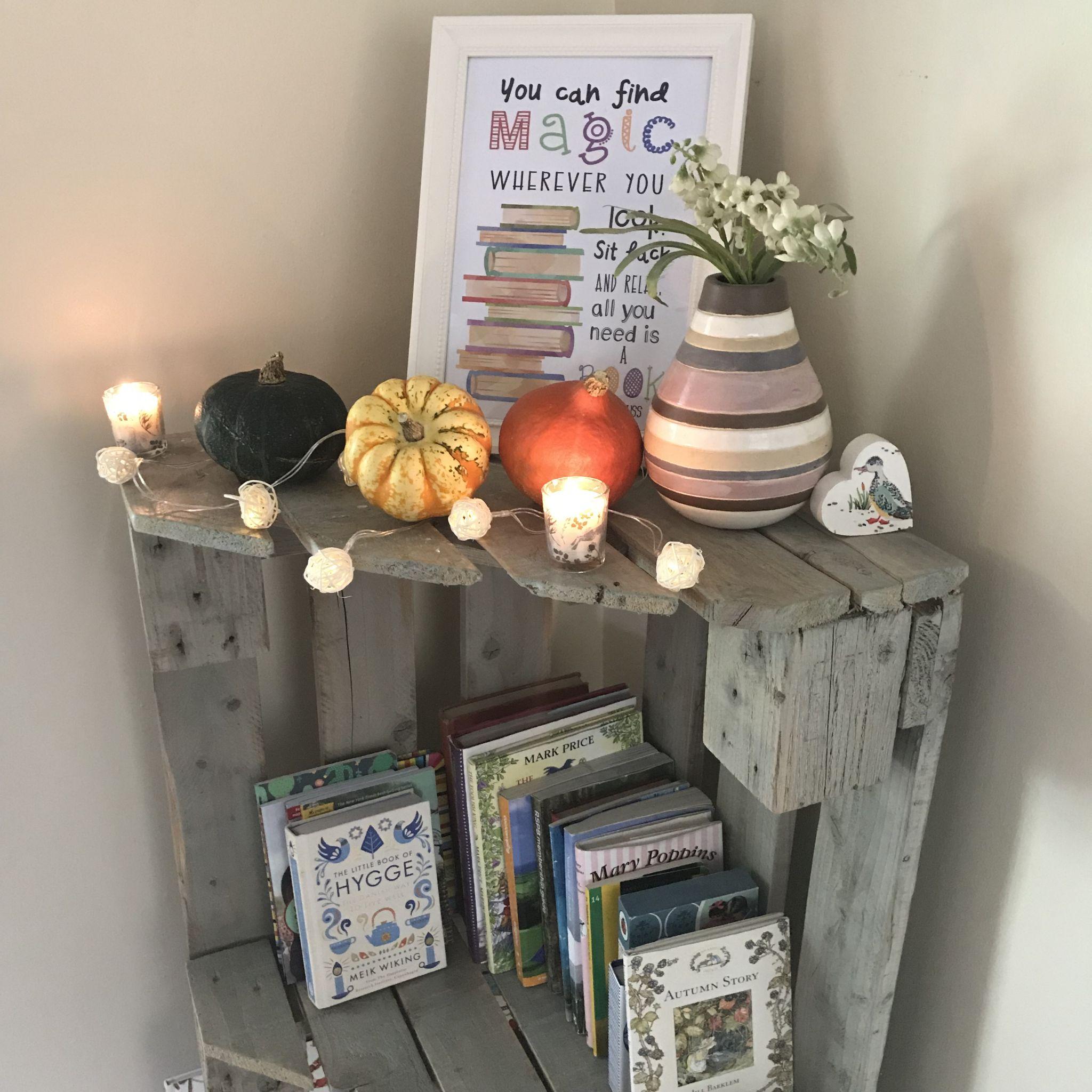 a bookshelf with fairy lights
