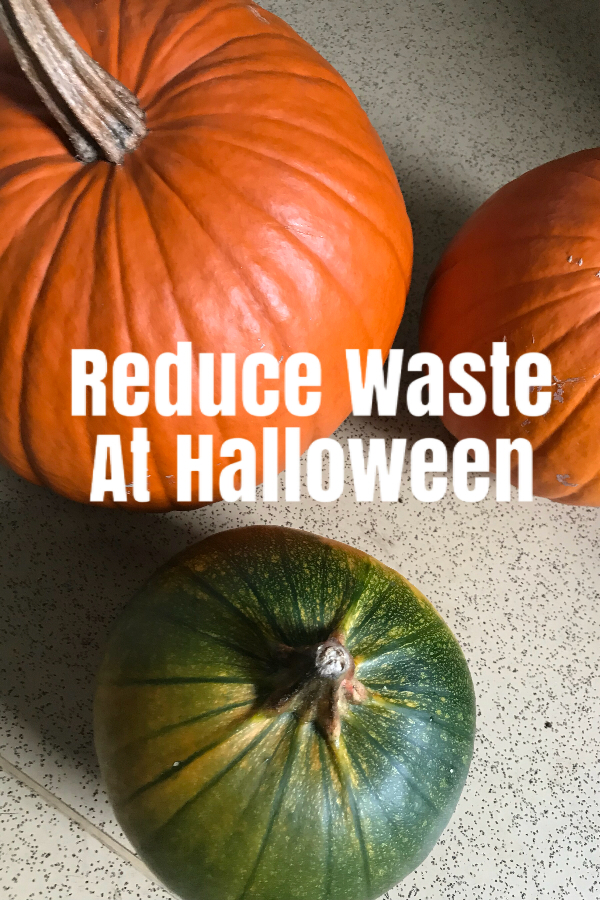 pumpkins with a sign saying reduce waste this Halloween