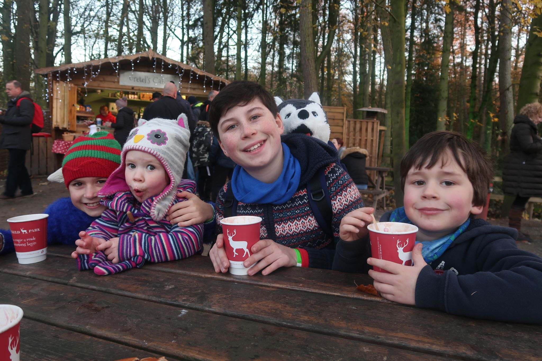 children drinking hot chocolate outside