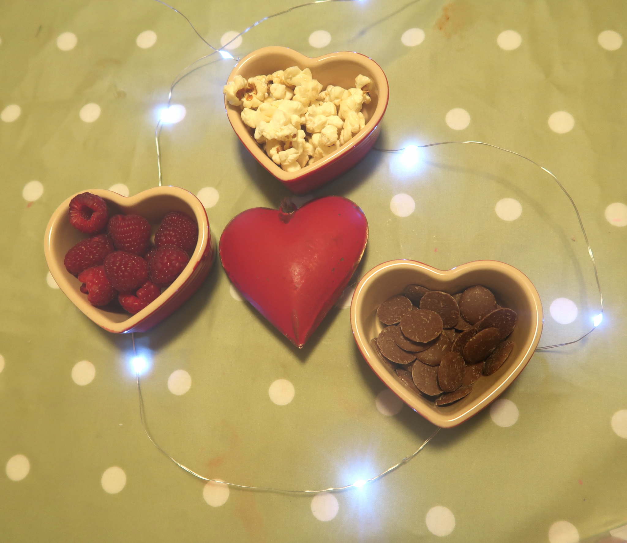 buttons, raspberries and popcorn in heart pots