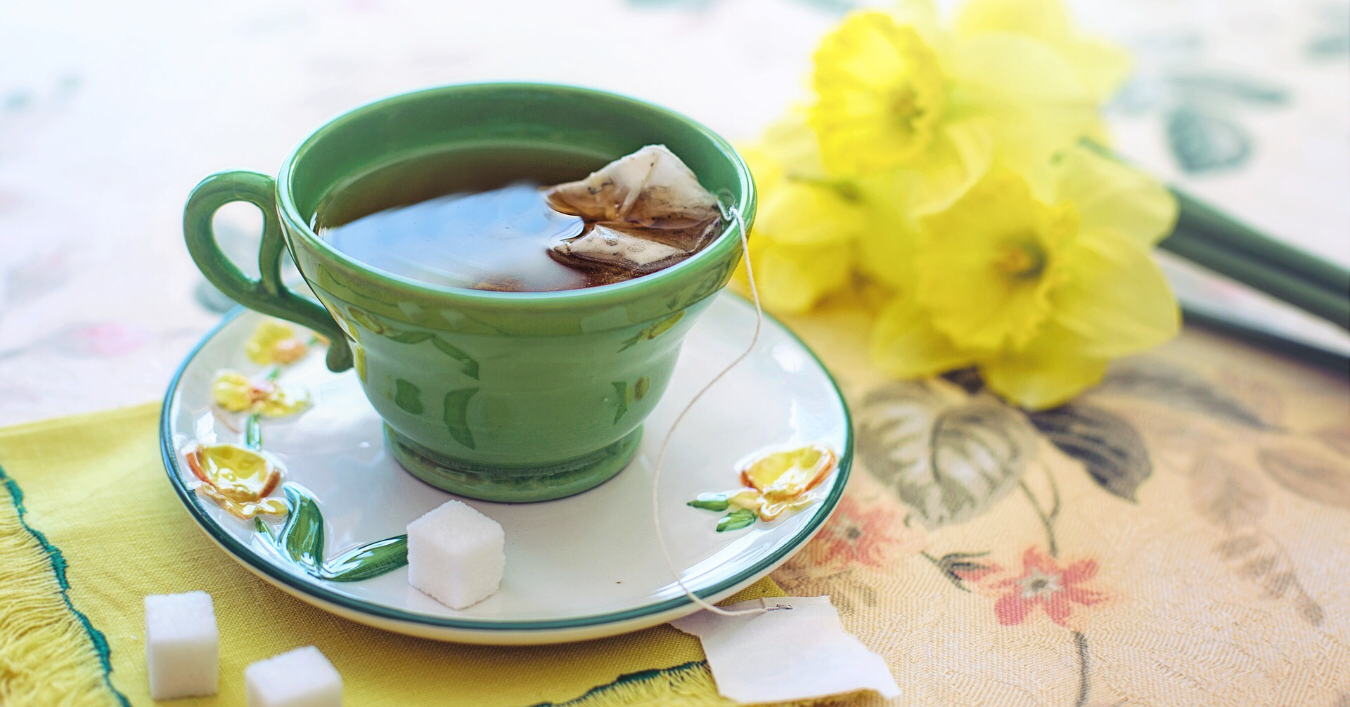 A cup of tea and daffodils