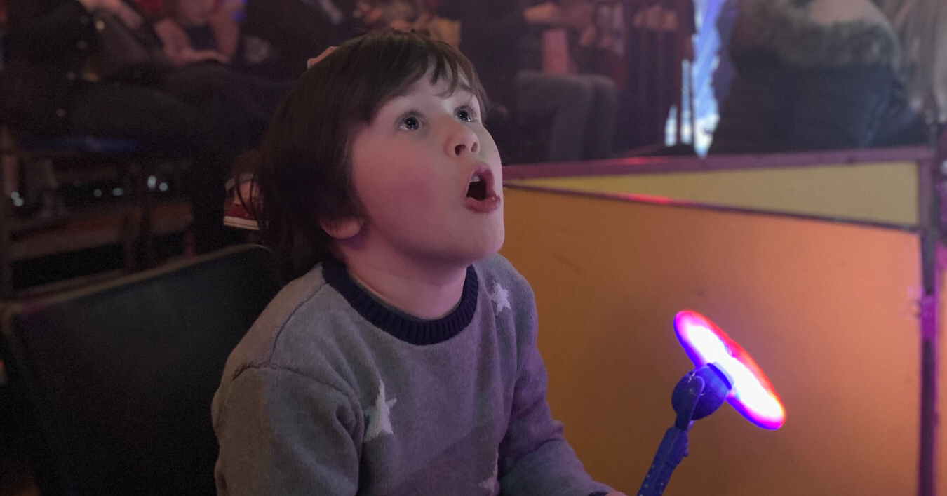 A boy excited by watching the circus