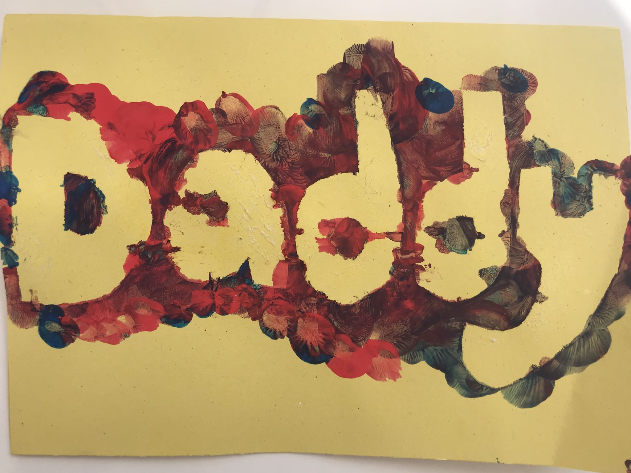 A fingerprinted painted card saying Daddy