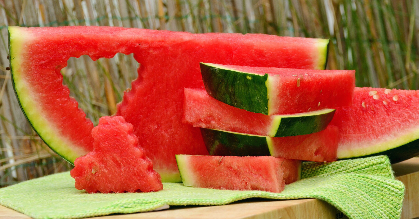 A watermelon cut up with a heart shape
