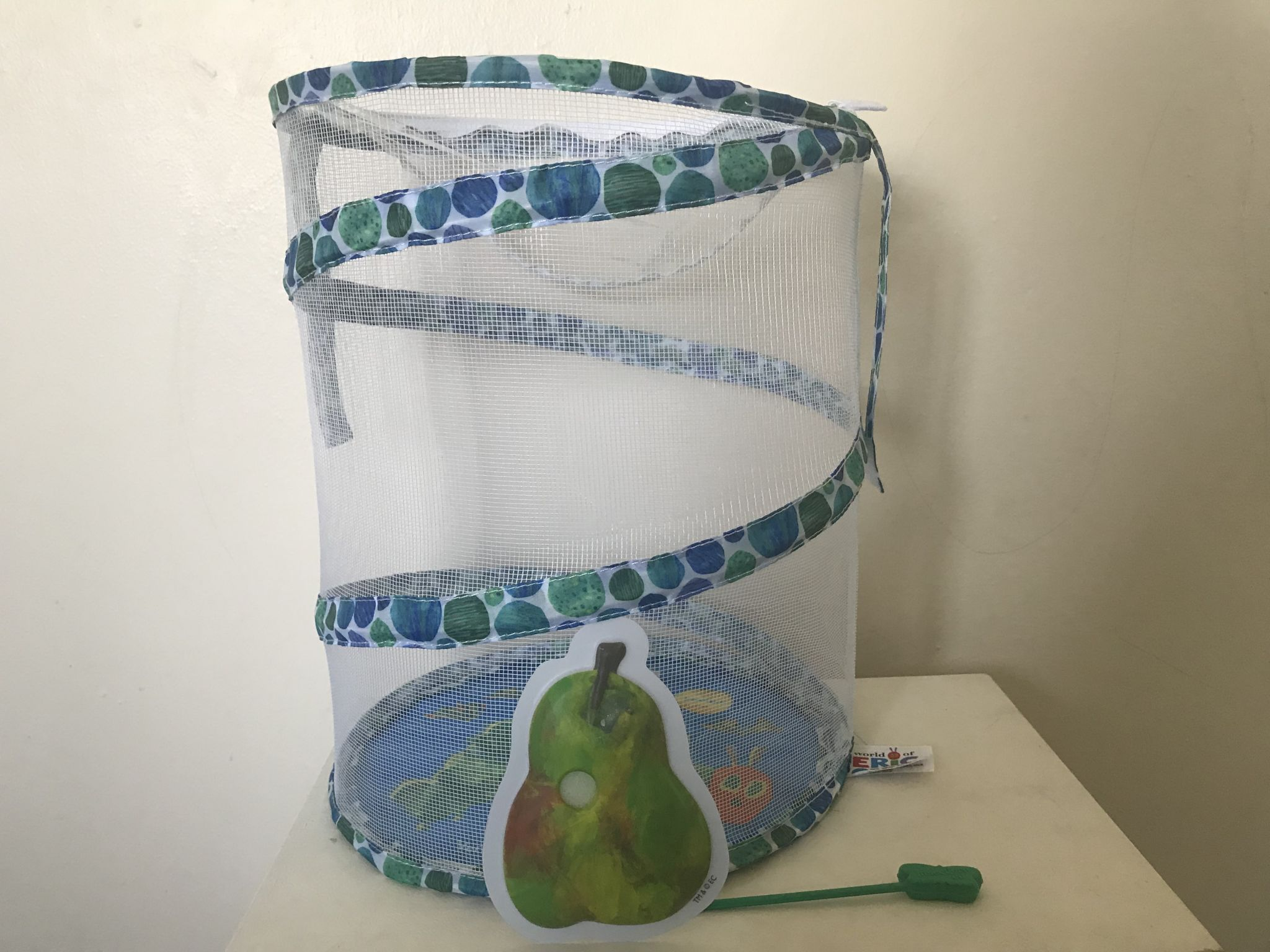 A butterfly net and pear shaped feeder