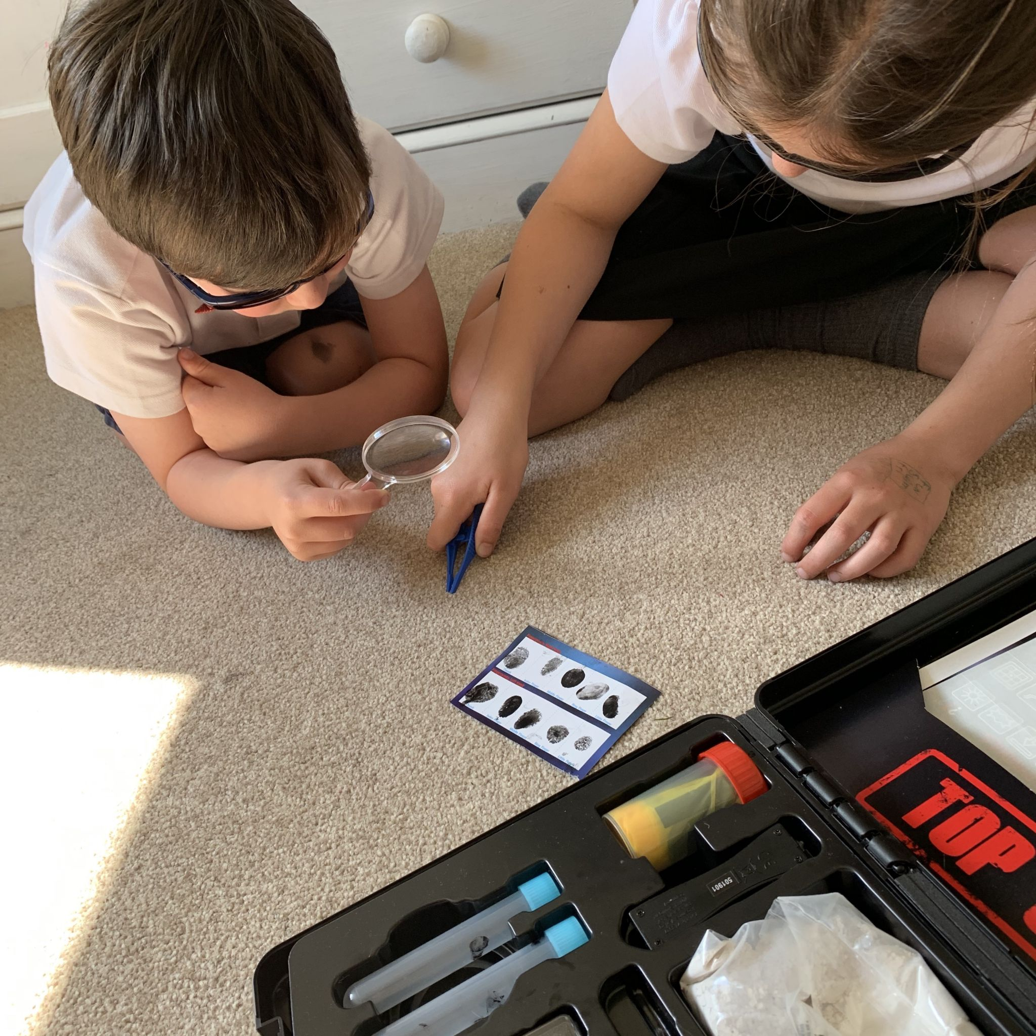 children playing with a spy case