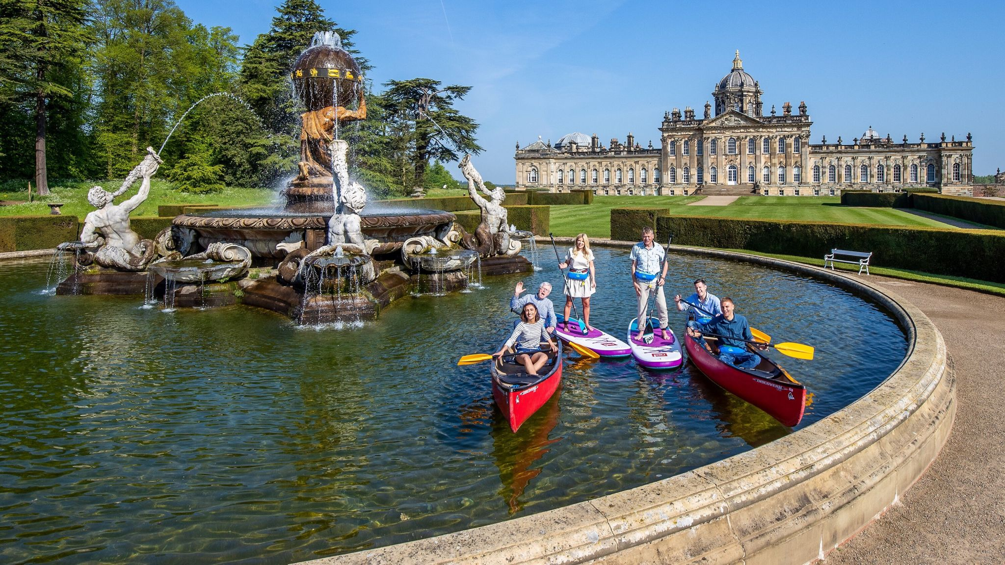 Countryfile presenters in a canoe in a fountain
