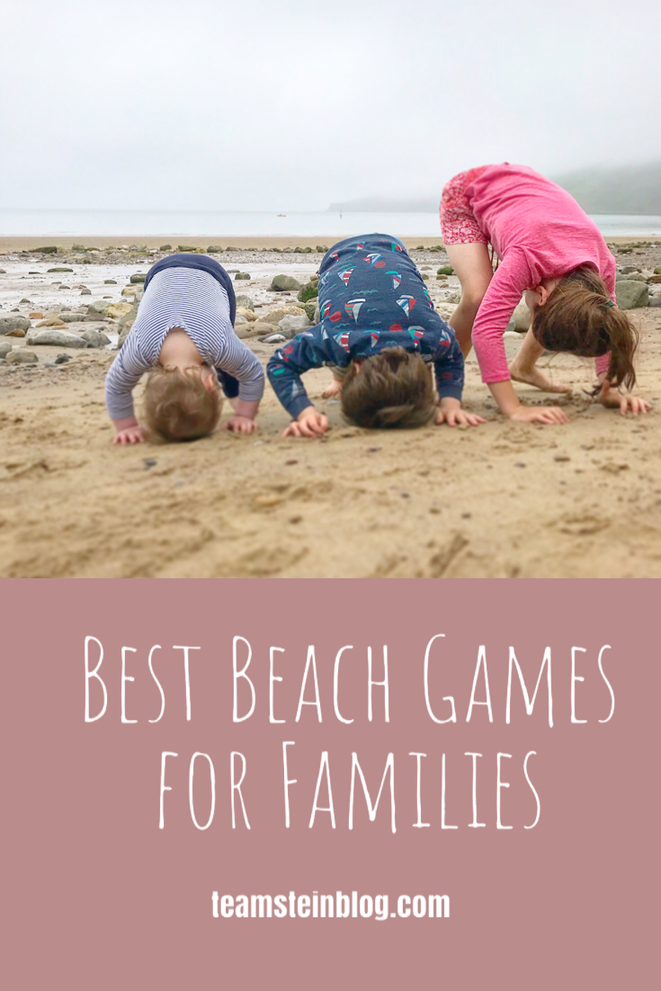 3 kids doing yoga on the beach