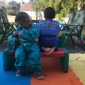 two children sat on a bench