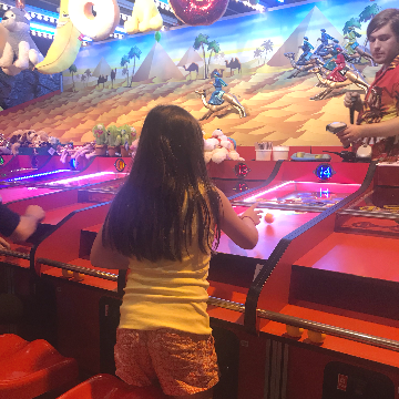 A child playing an amusement arcade game