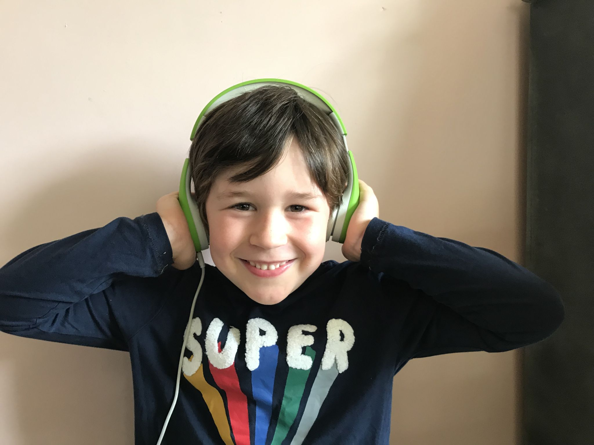 Boy wearing headphones smiling