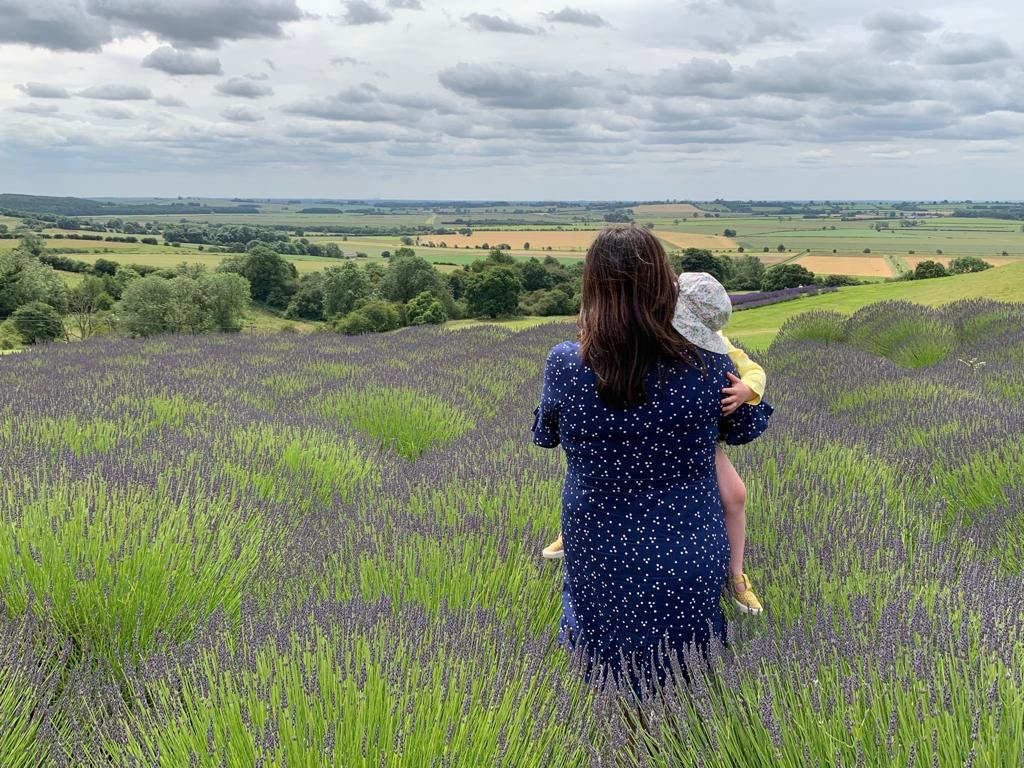 Mum and child in lavender fields looking out at the view