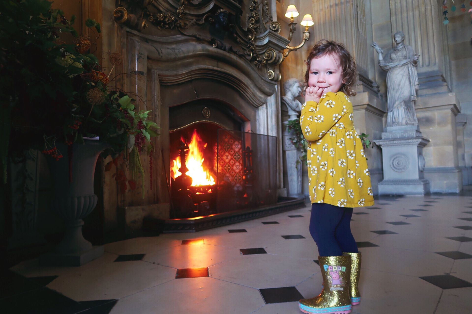 Little girl in front of an open fire