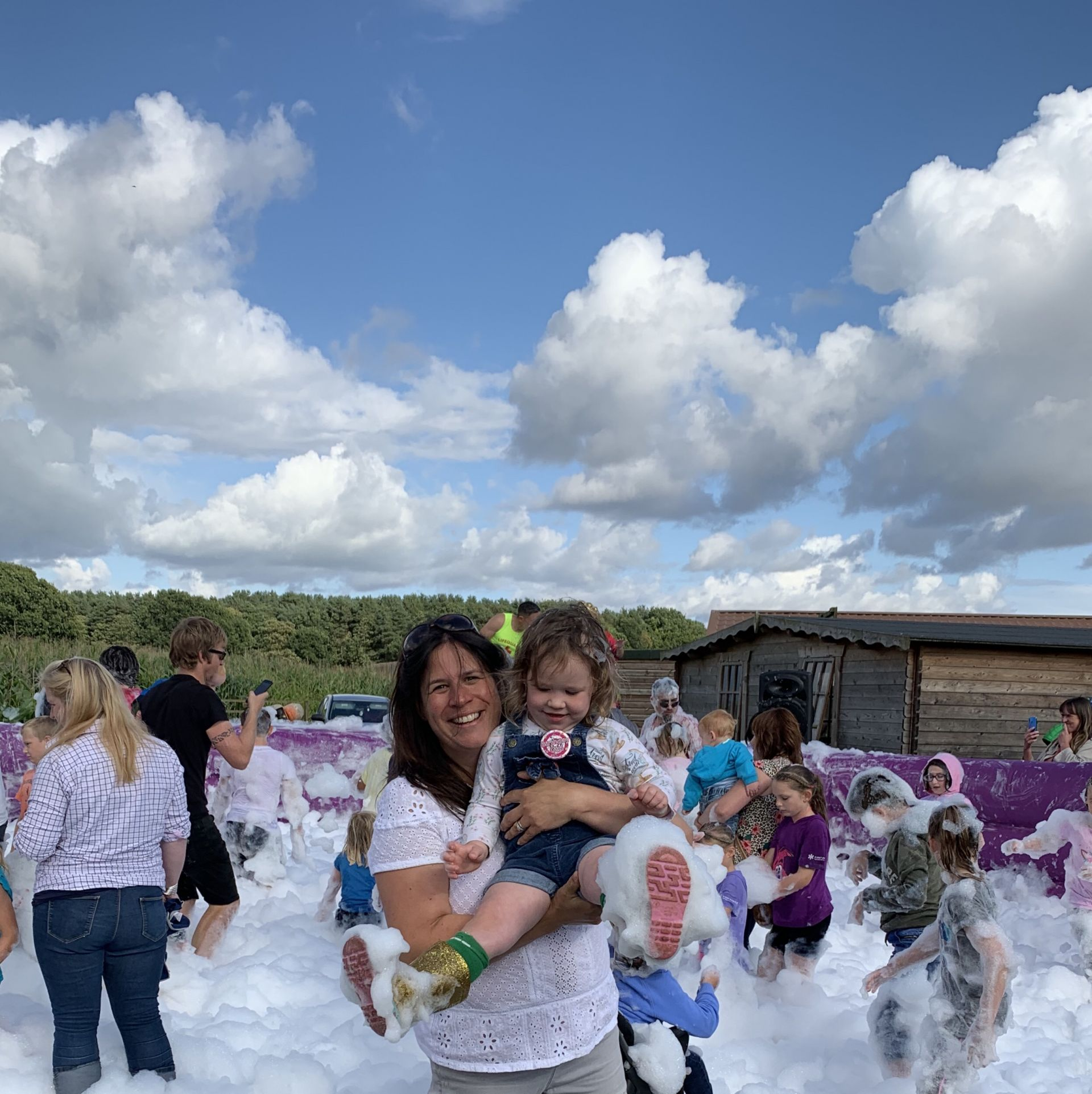 Mum and daughter playing in foam