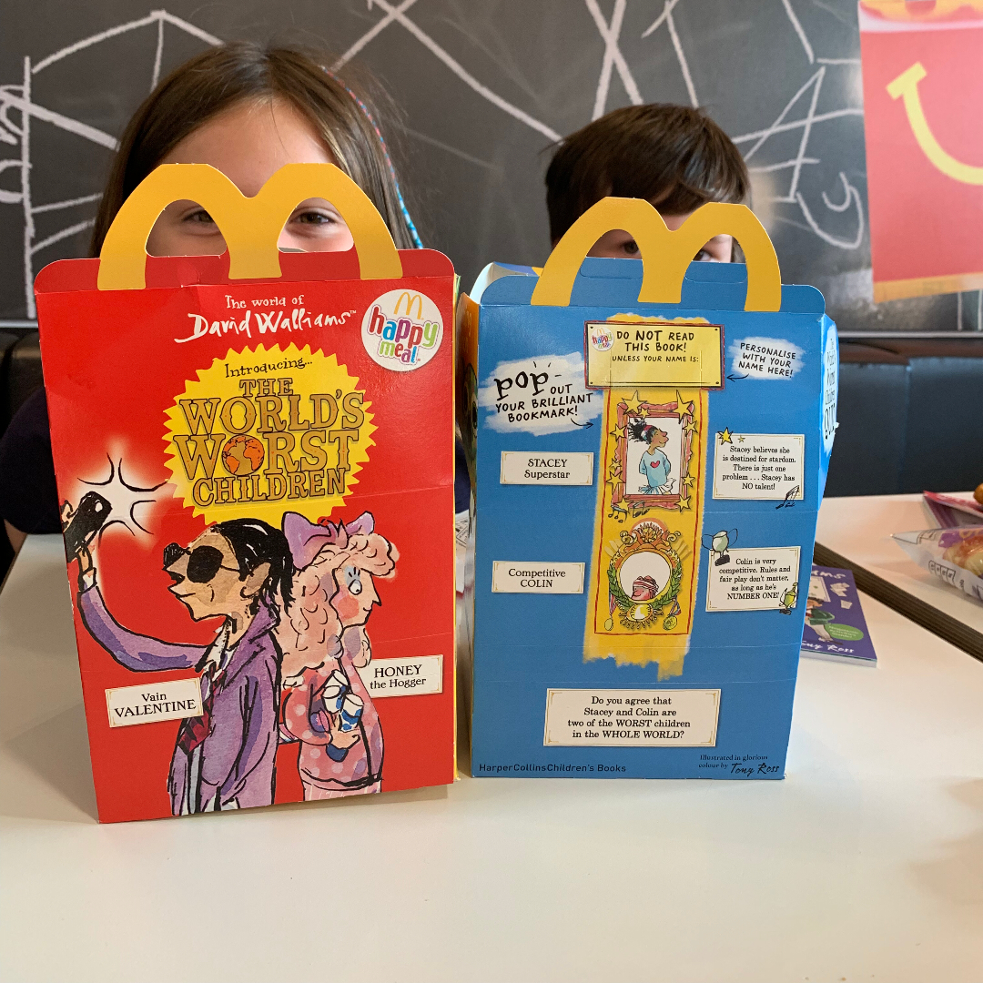 Two children with their happy meal boxes