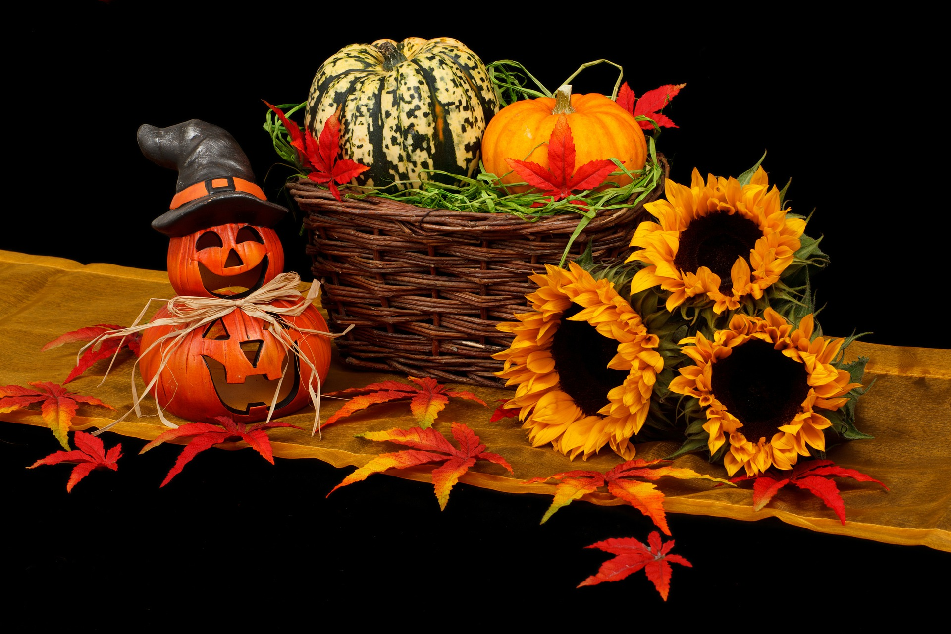 sunflowers and pumpkins in a basket