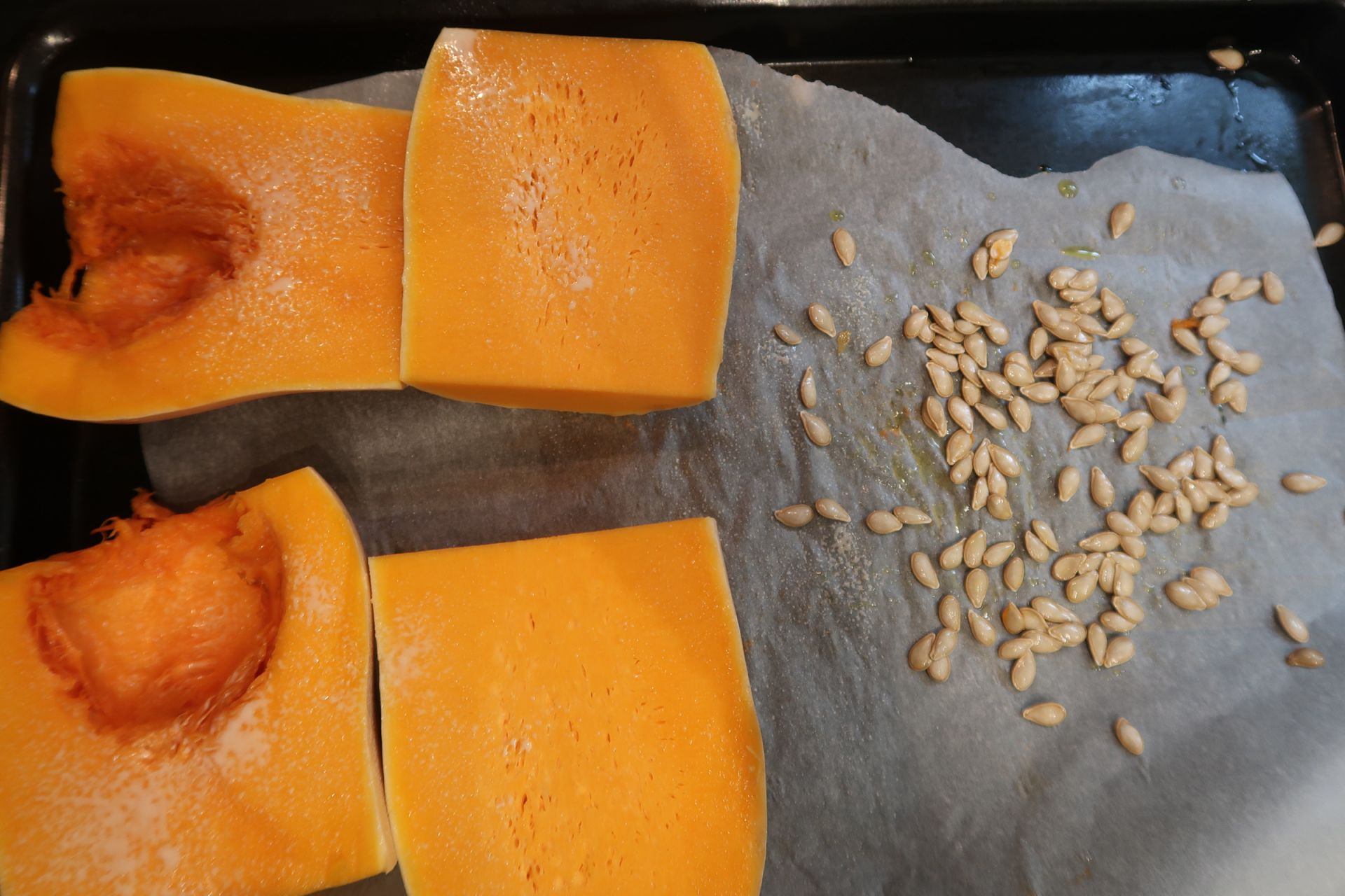 pumpkin and squash roasting in the oven