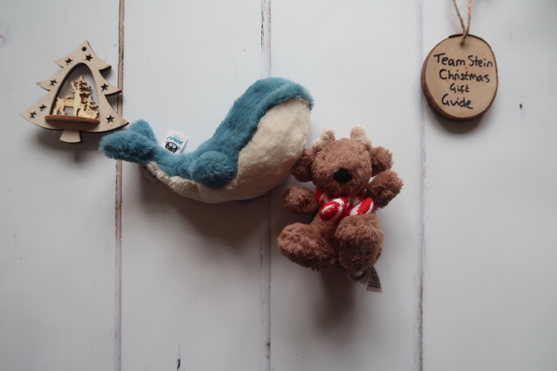 a stuffed toy whale and stuffed reindeer