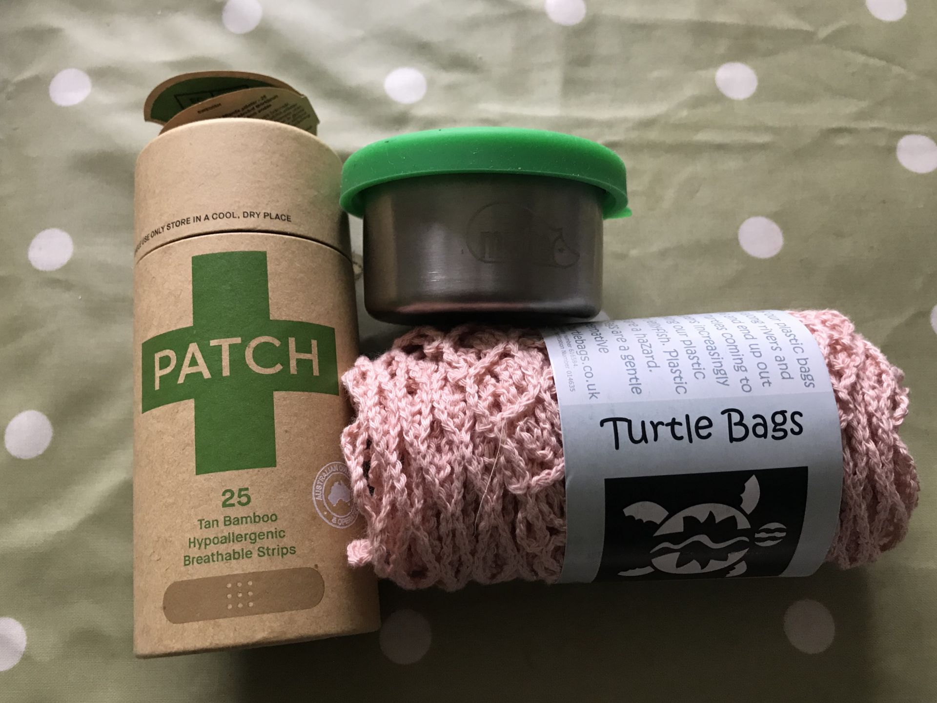 plasters, turtle bag and a stainless steel pot