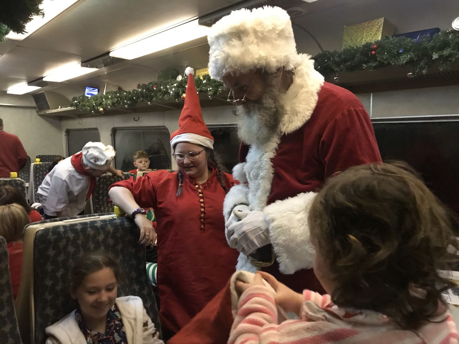 children meeting Santa