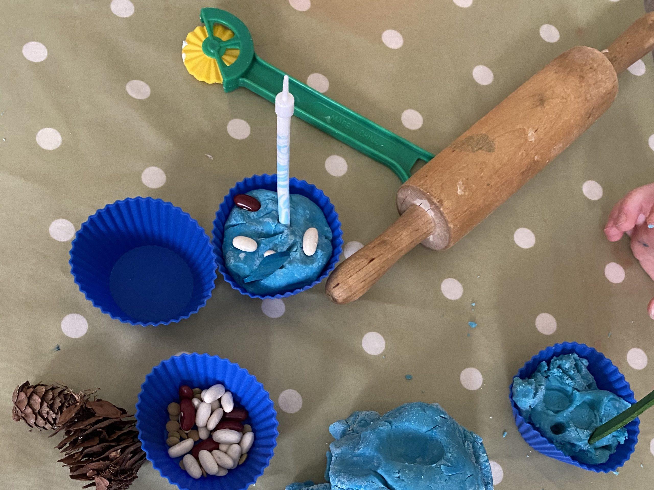 indoor preschooler activity of play dough birthday cupcakes
