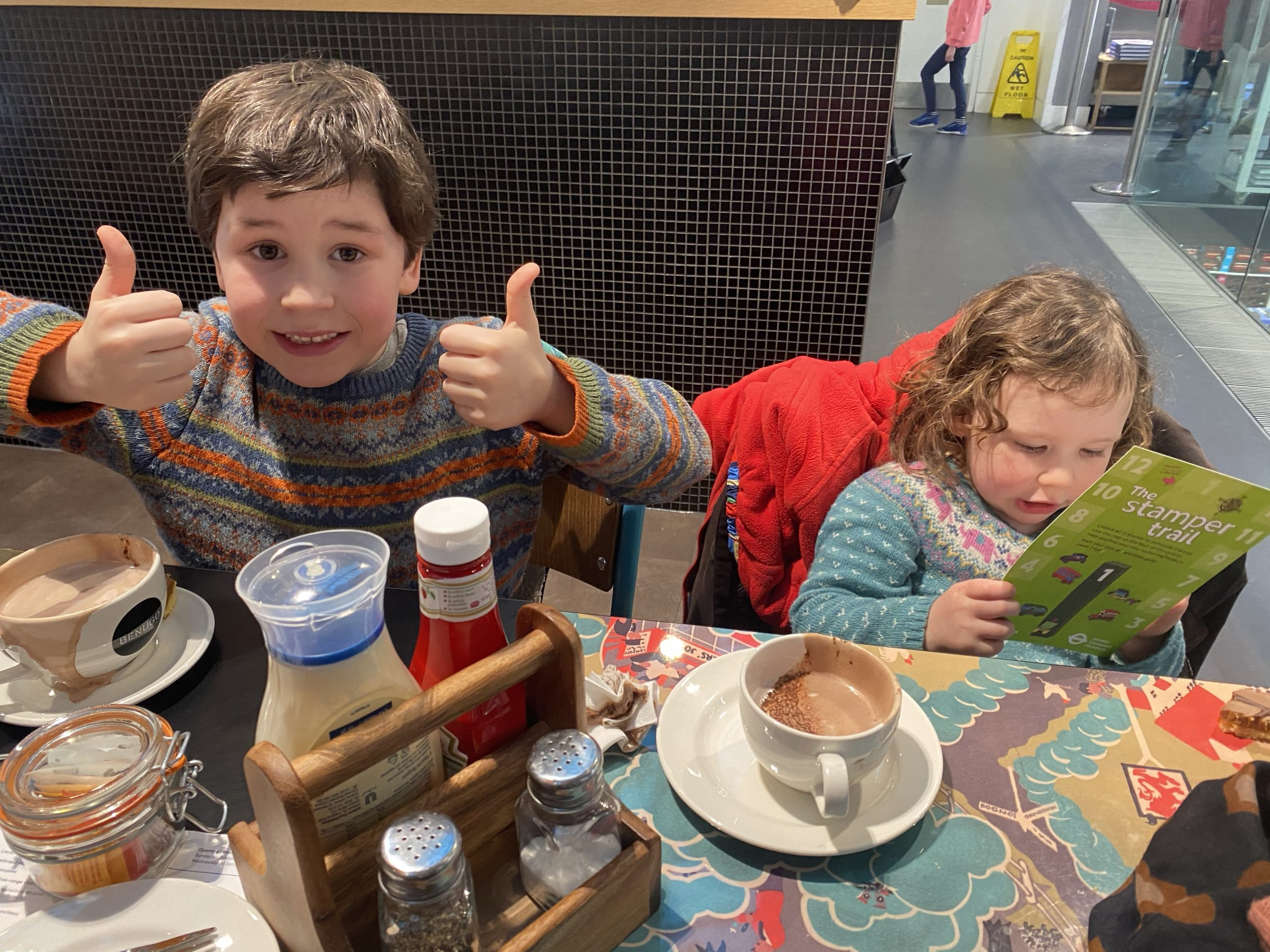 The London Transport Museum cafe with two children having hot chocolate
