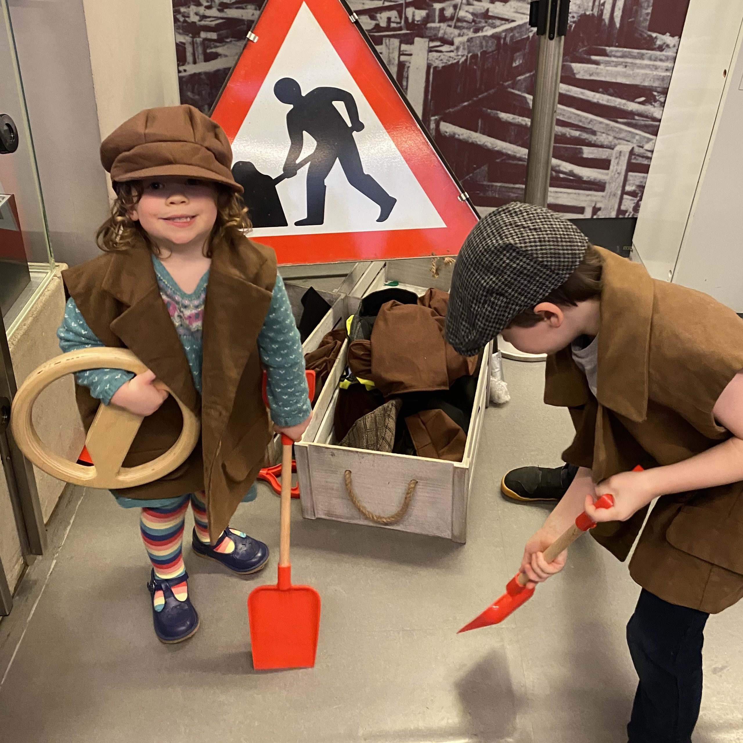 Two children role playing as underground workers