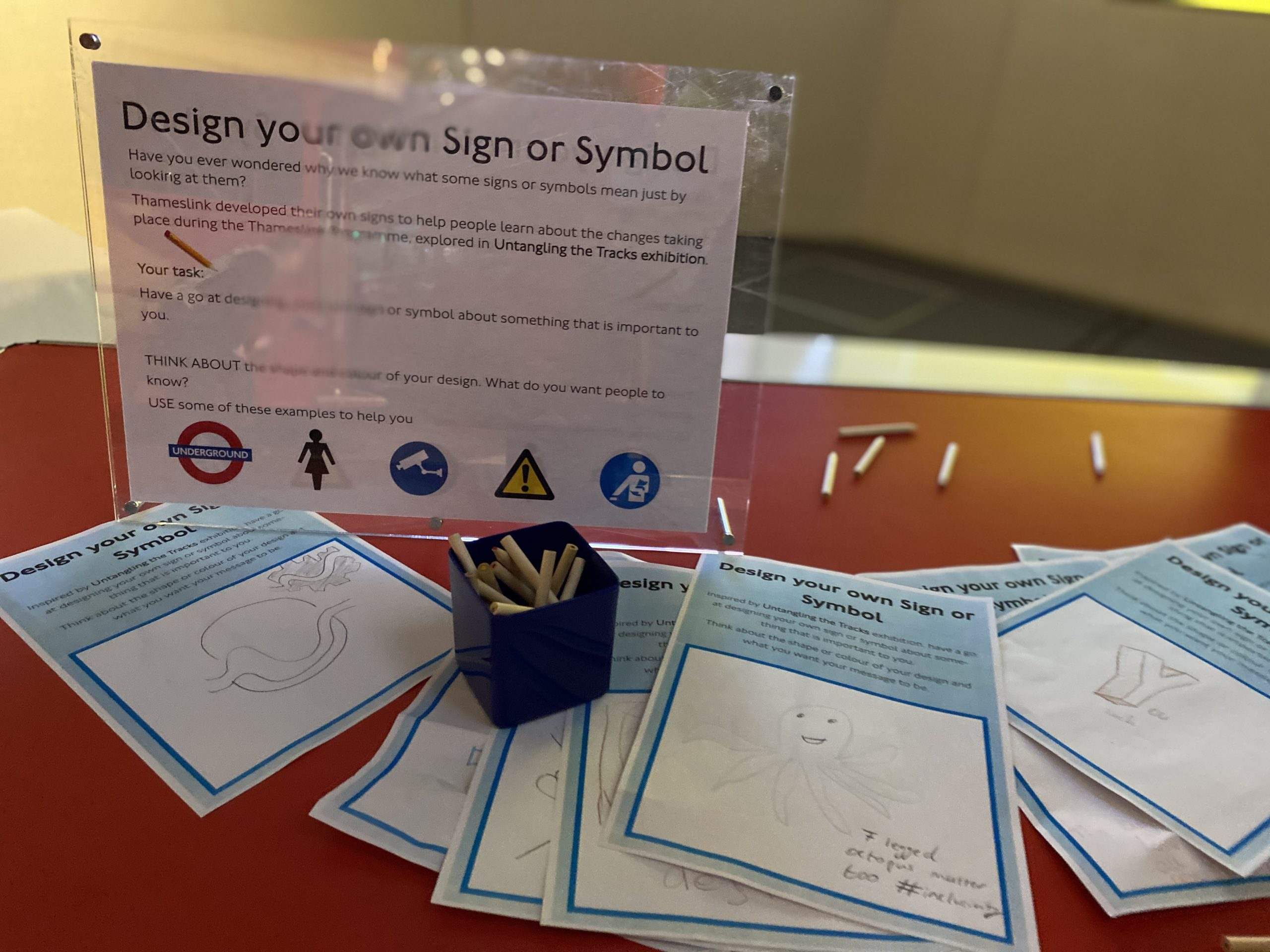 Colouring pencils and paper for designing transport signs