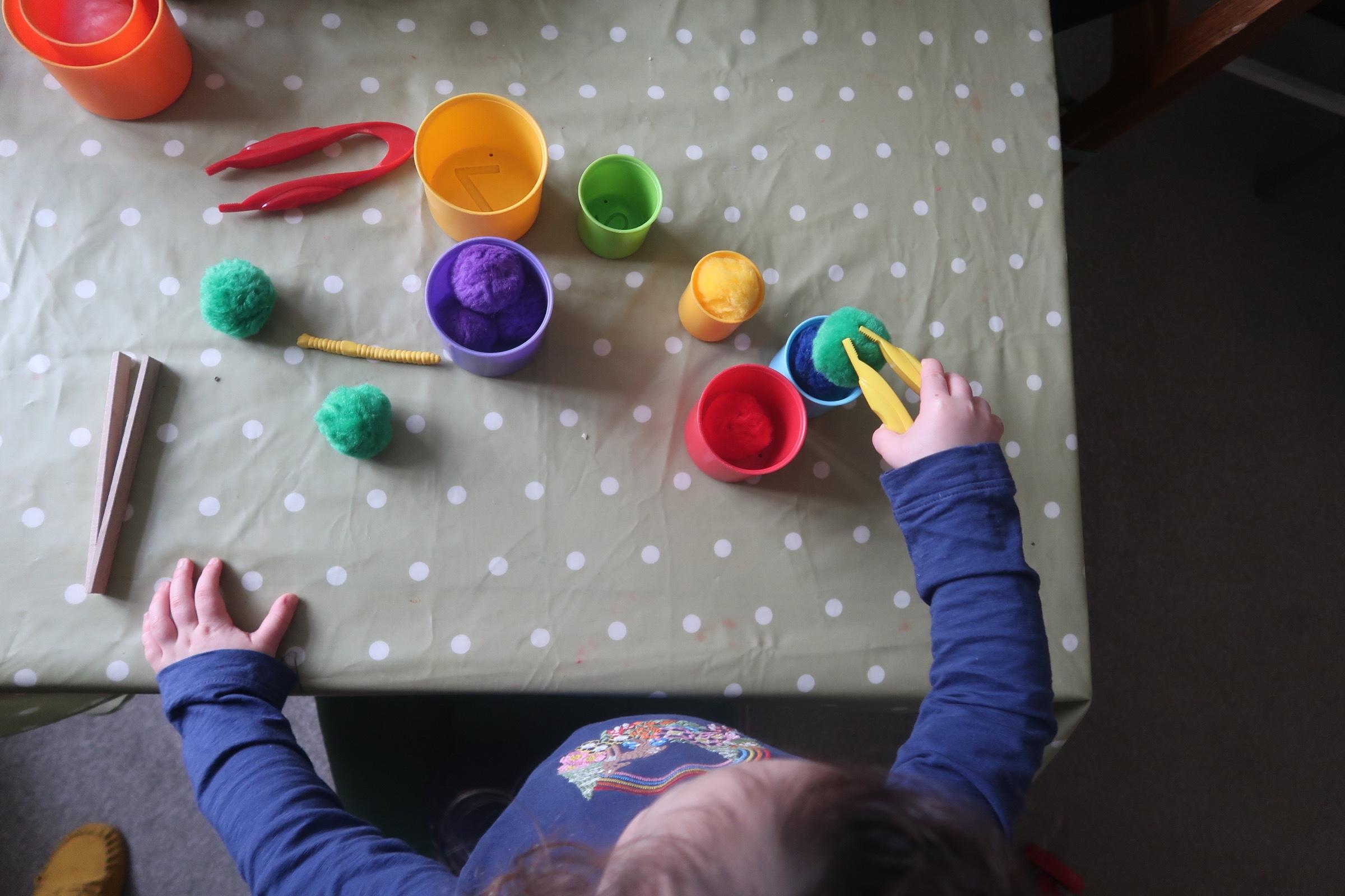 pom poms and cups for  indoor preschooler activities