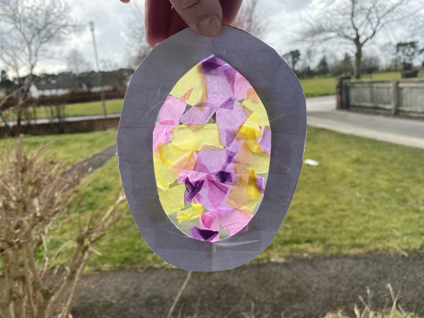Easter Suncatcher craft hanging in a window