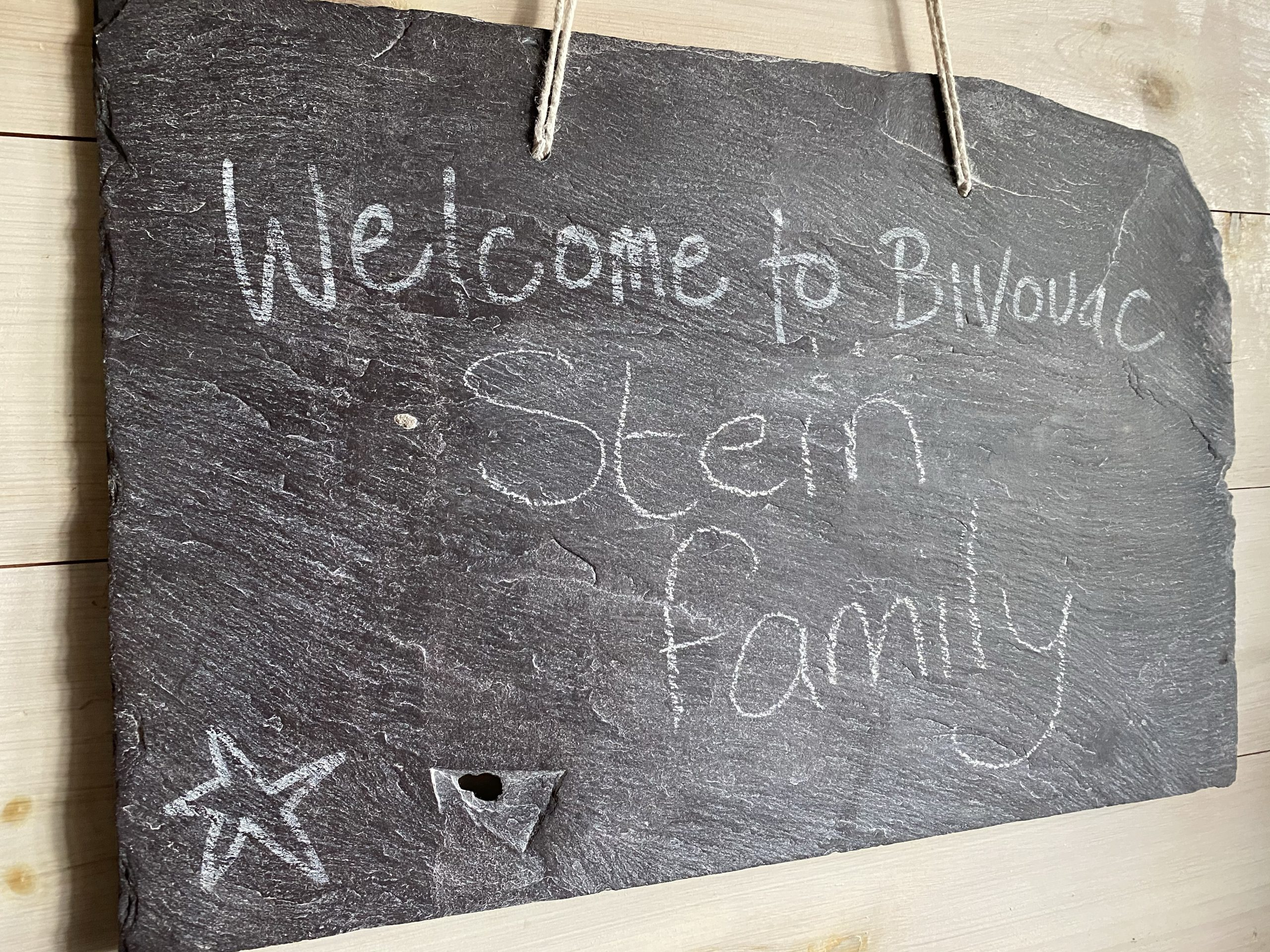 Swinton Bivouac tree lodge welcome sign