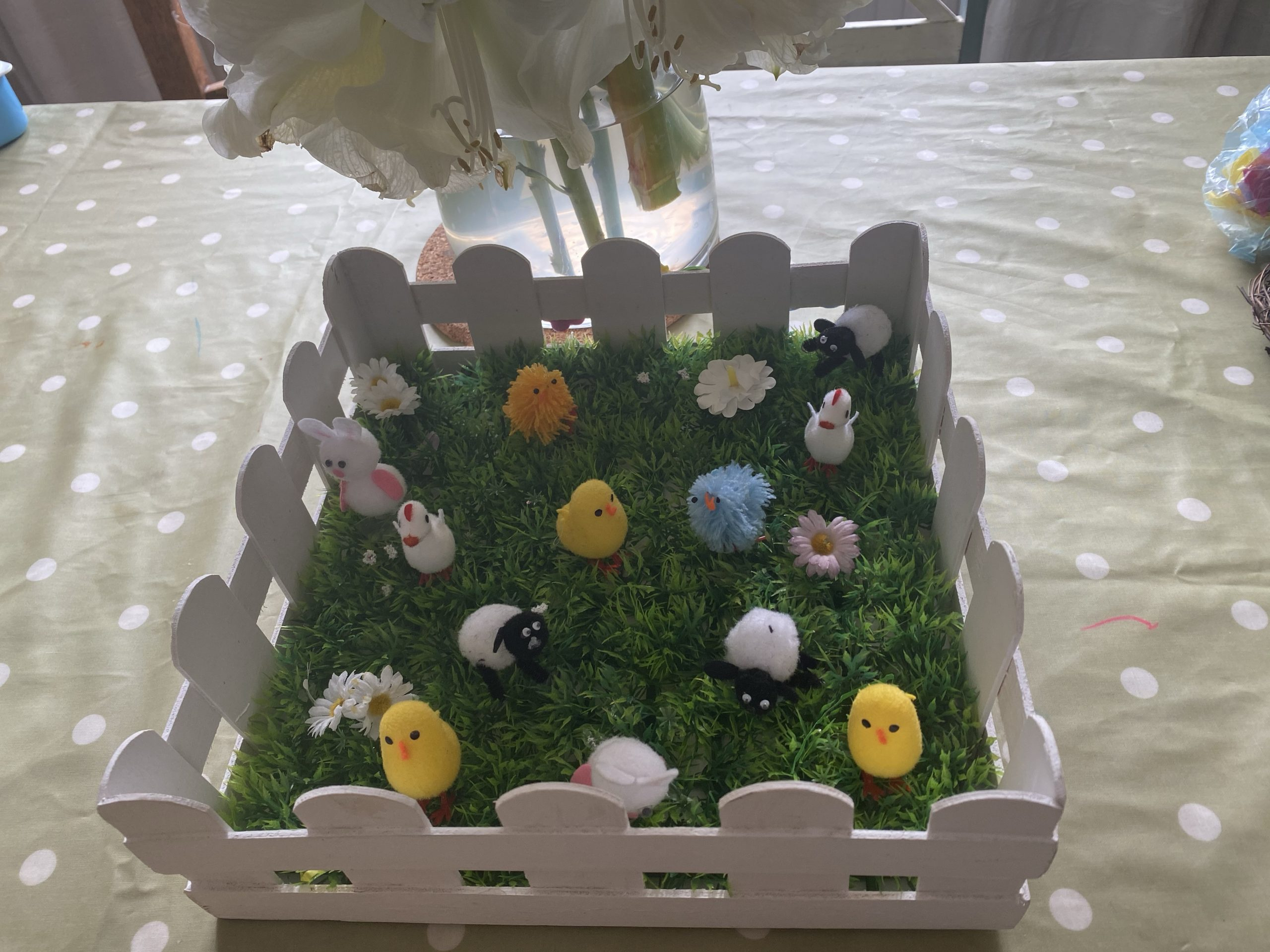 a faux Easter garden filled with little chicks, bunnies, sheeps and geese