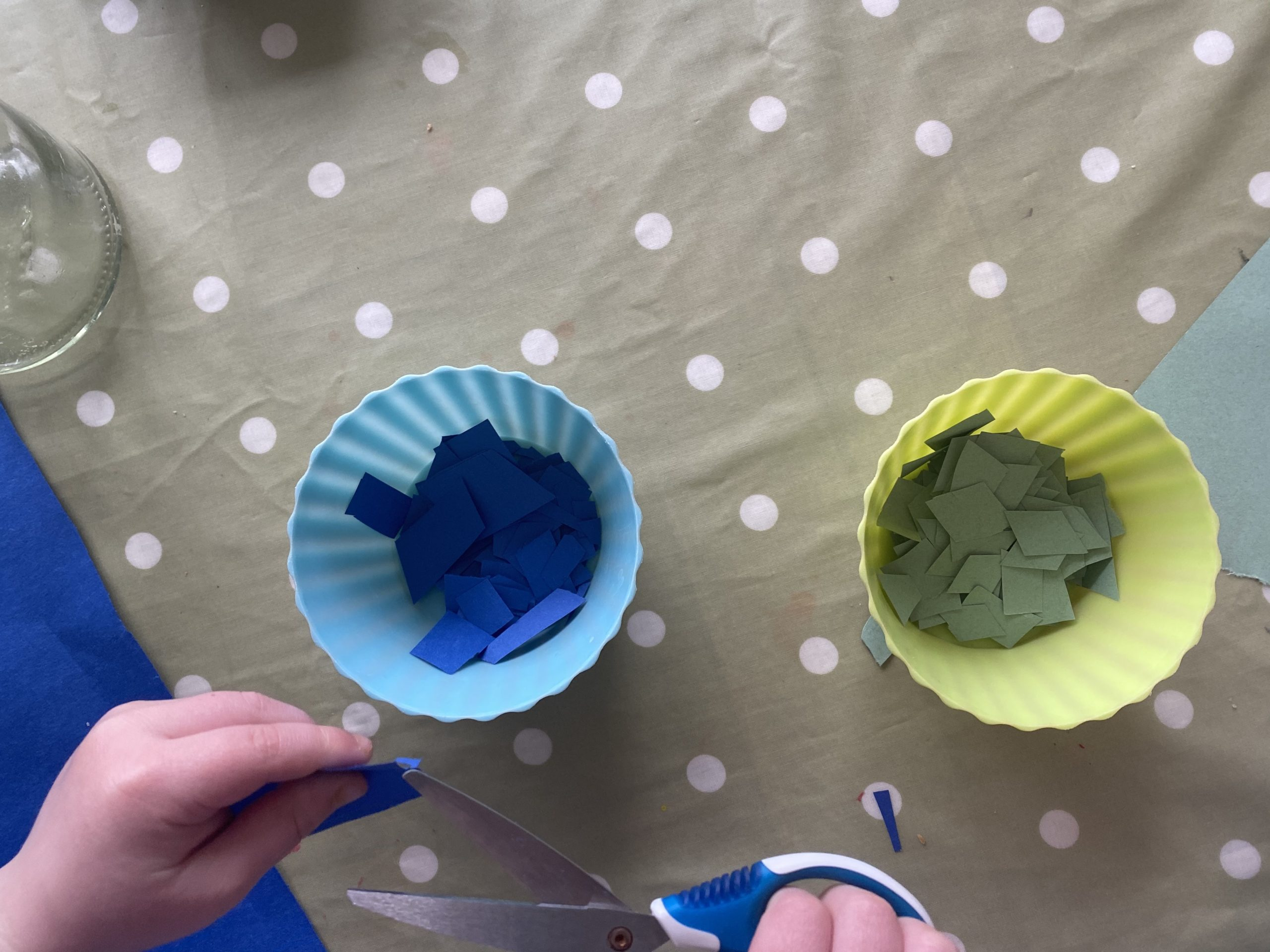 children cutting coloured paper