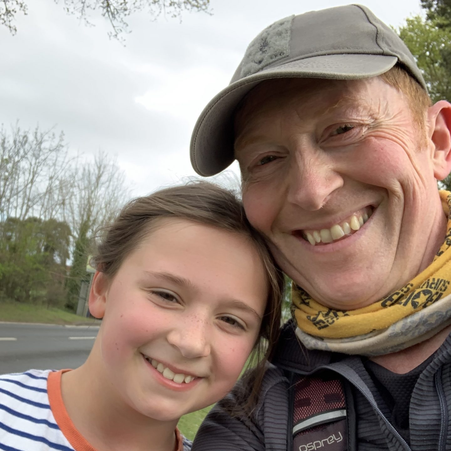 a father and daughter posing for a selfie after a jog