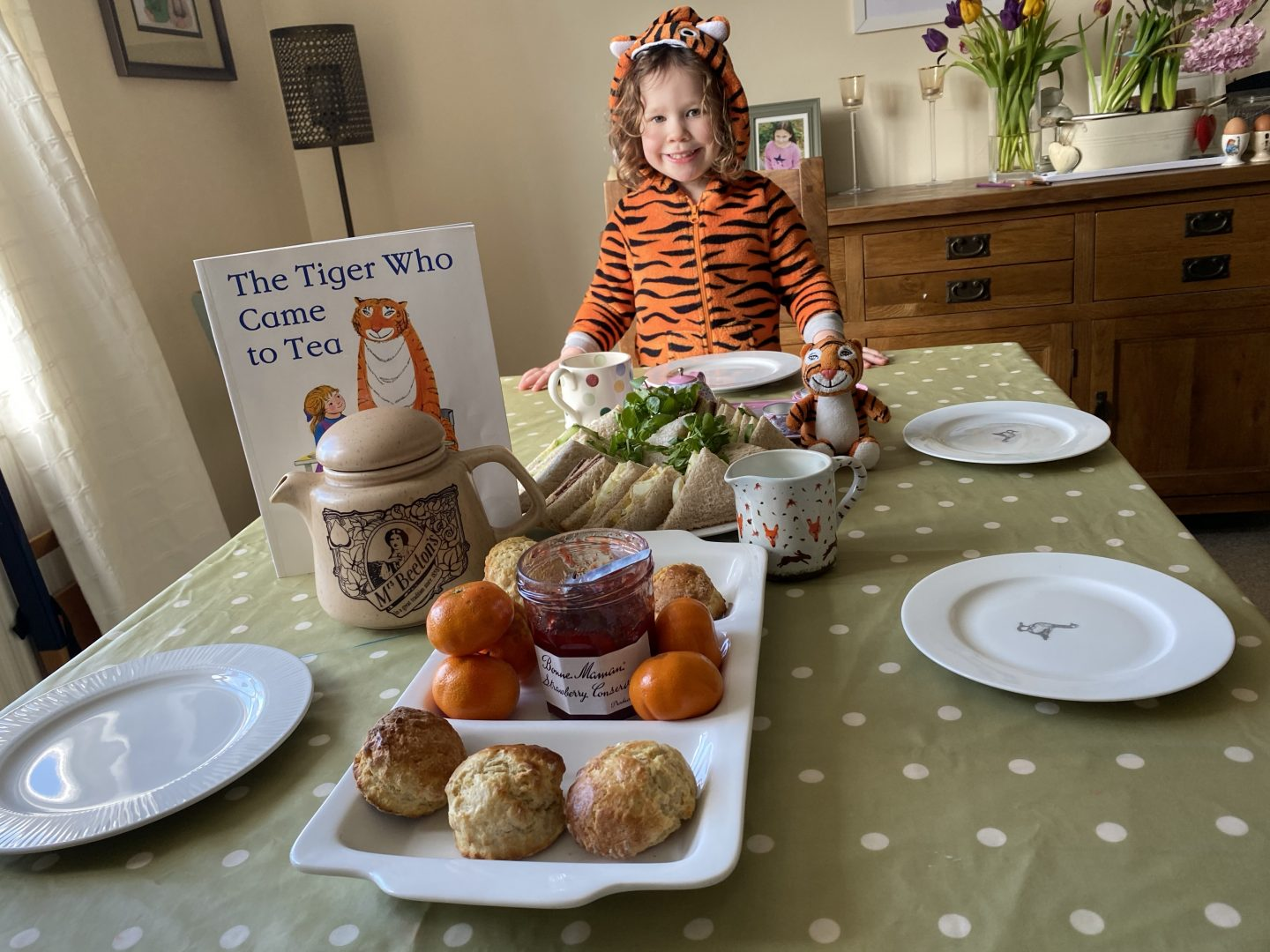 Tiger who came to tea, tea partywith a little girl dressed as a tiger and afternoon tea food