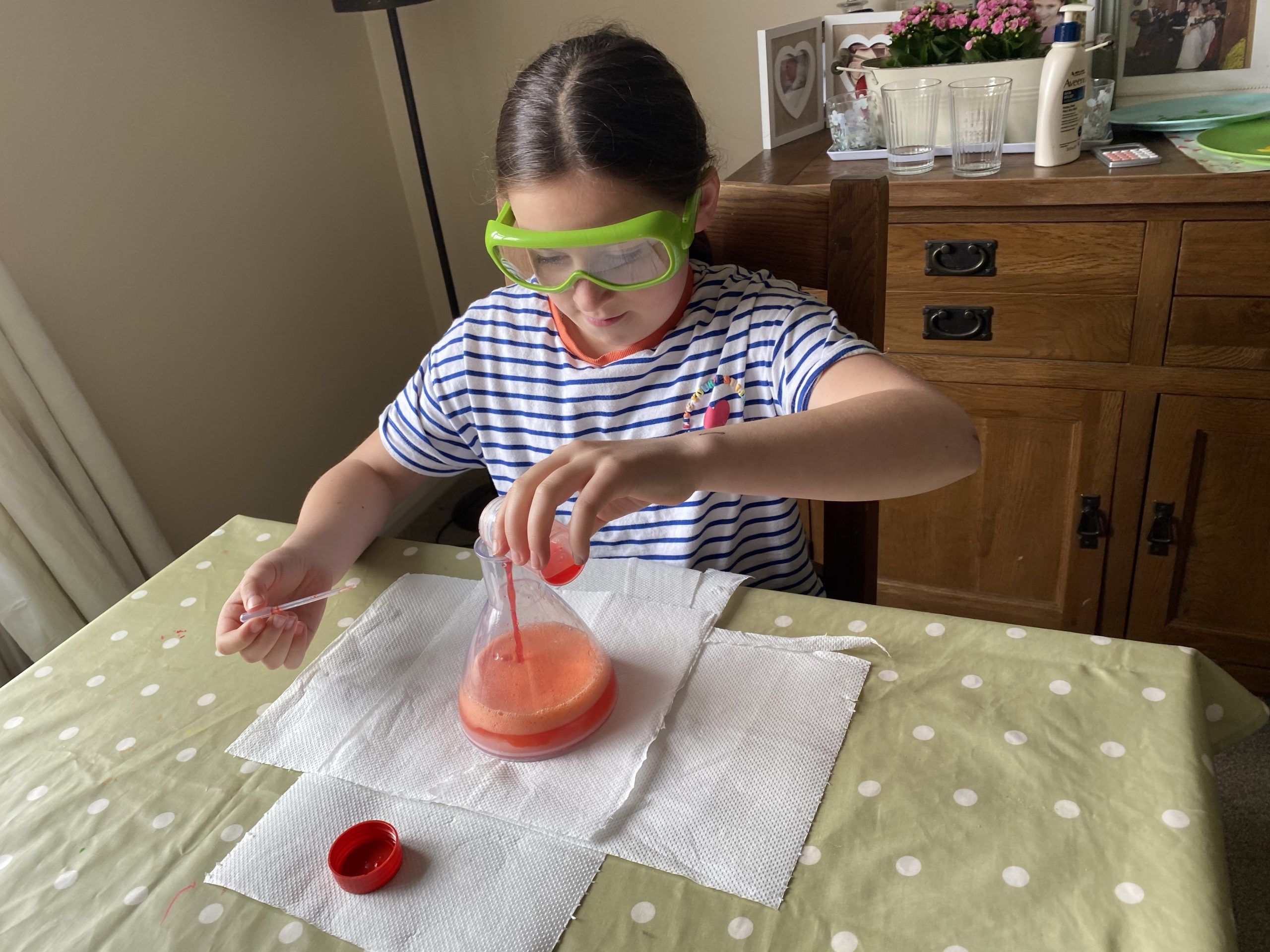 Lockdown science activities with a girl making a volcano