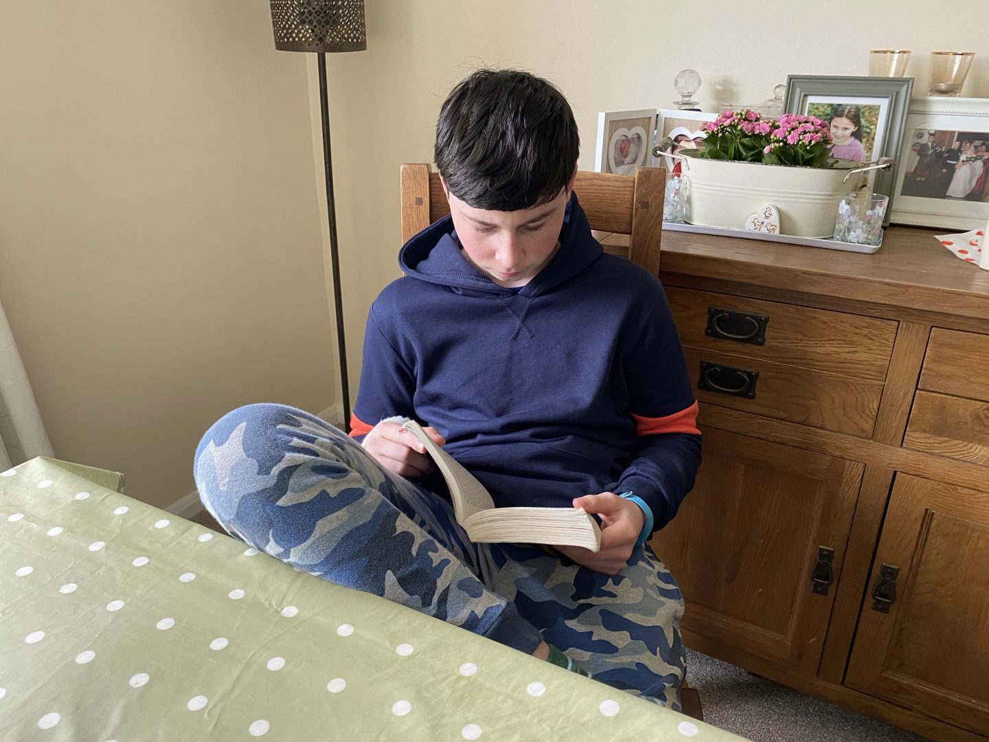 A boy reading quietly