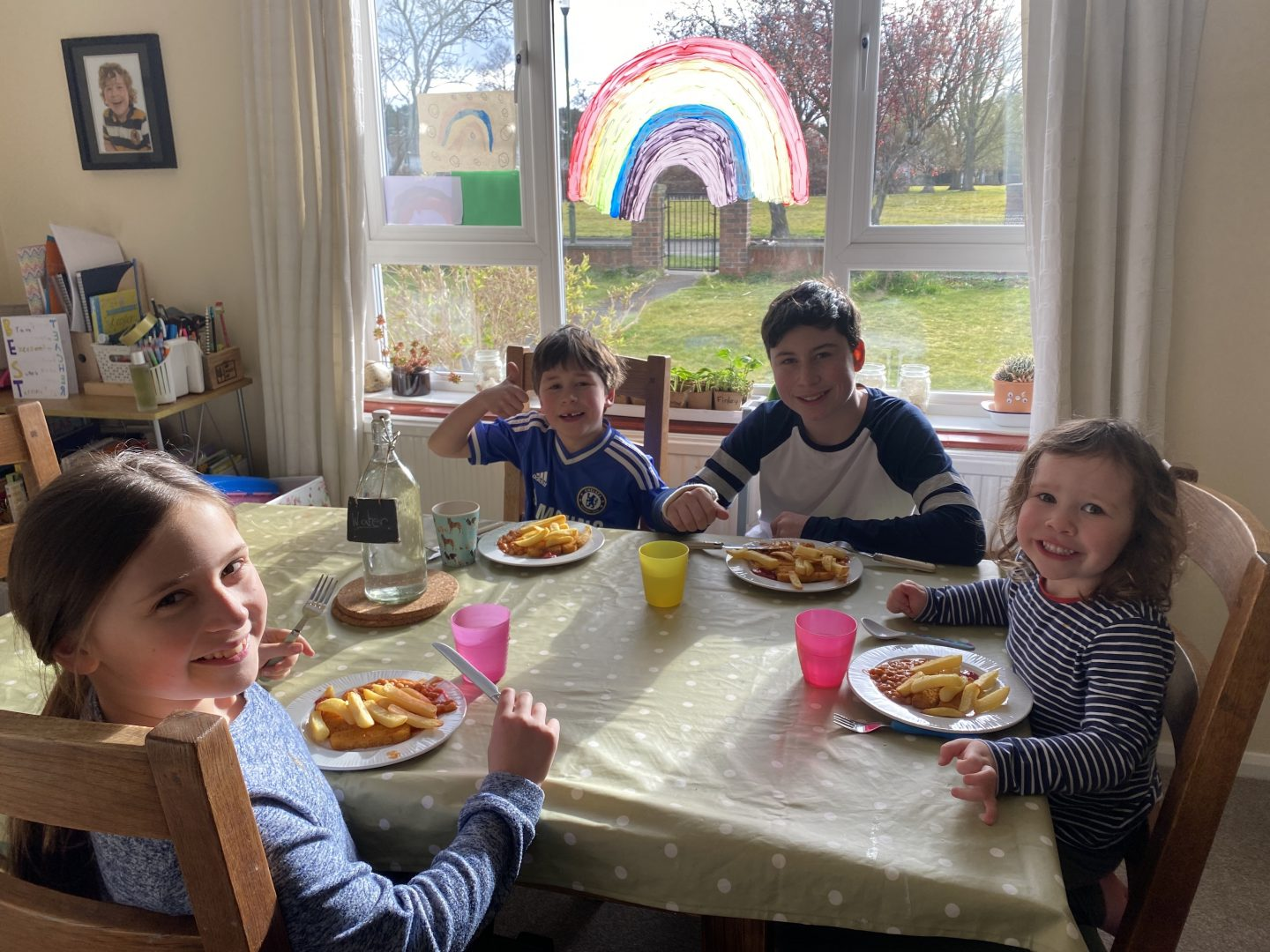 four children eating around the table