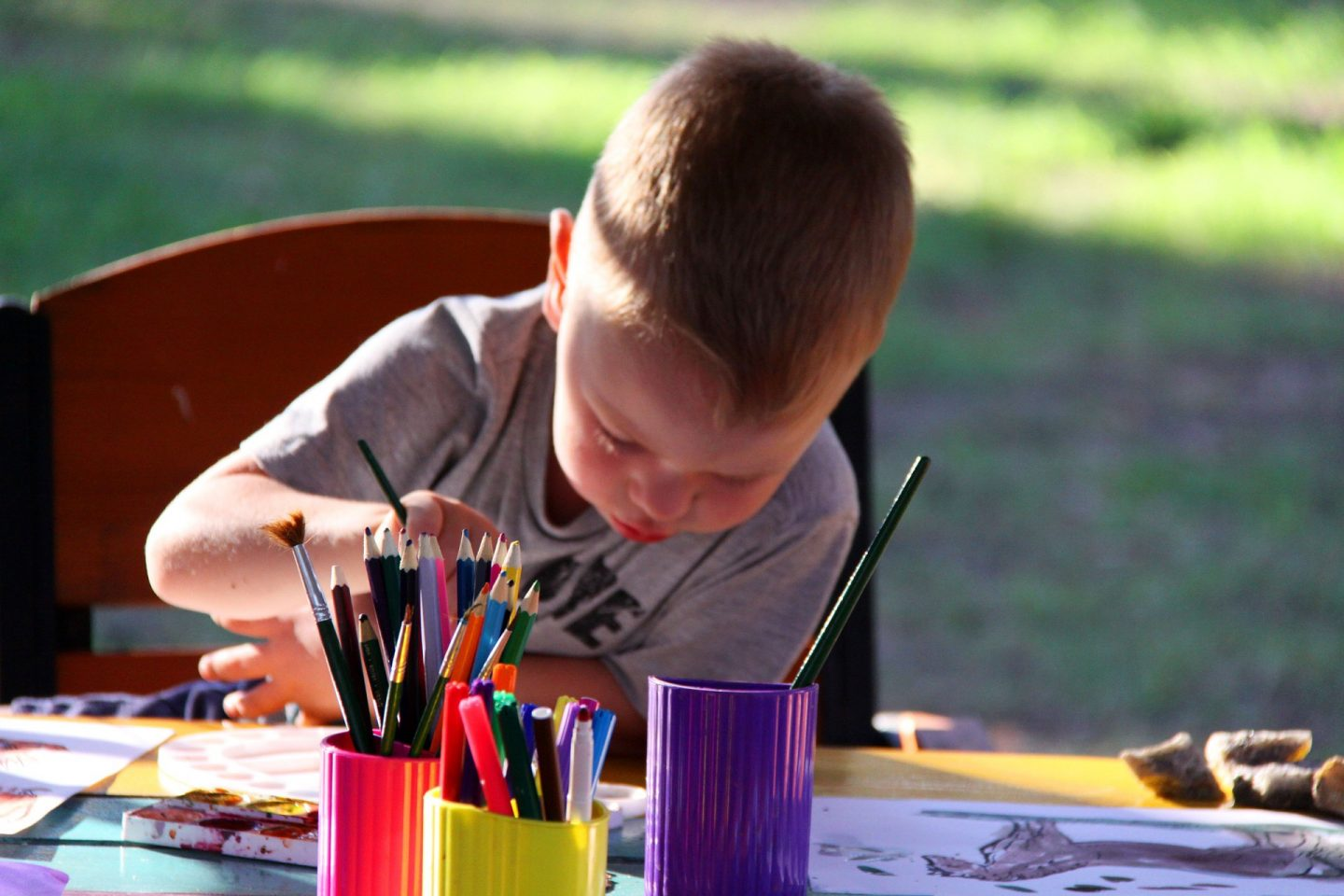Lockdown party ideas - A boy painting in the garden