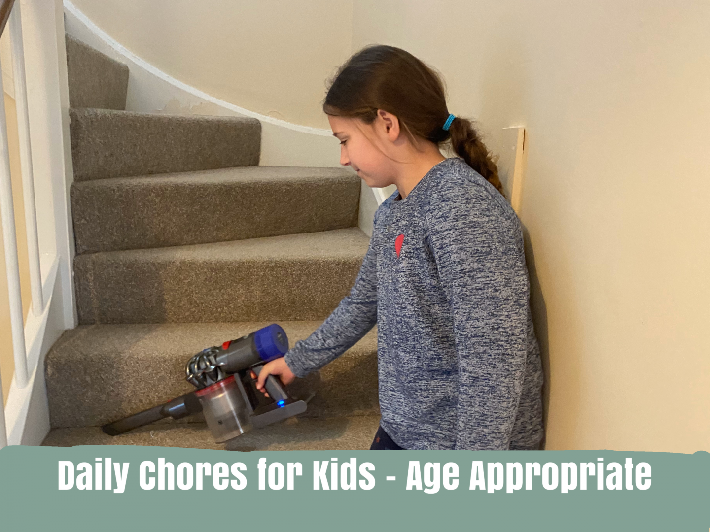 A girl doing chores - hoovering they stairs