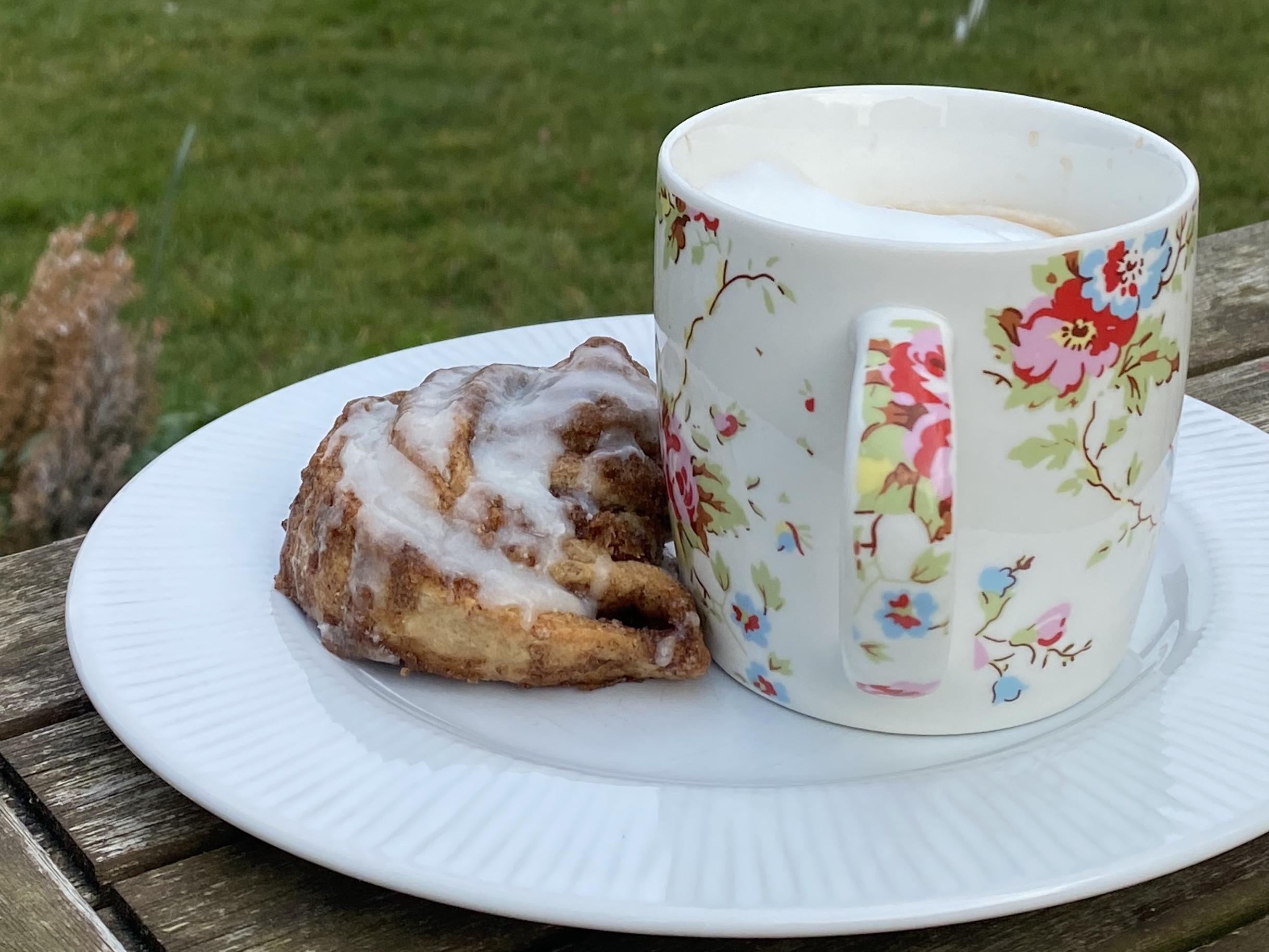 A coffee and cinnamon bun for a self care break