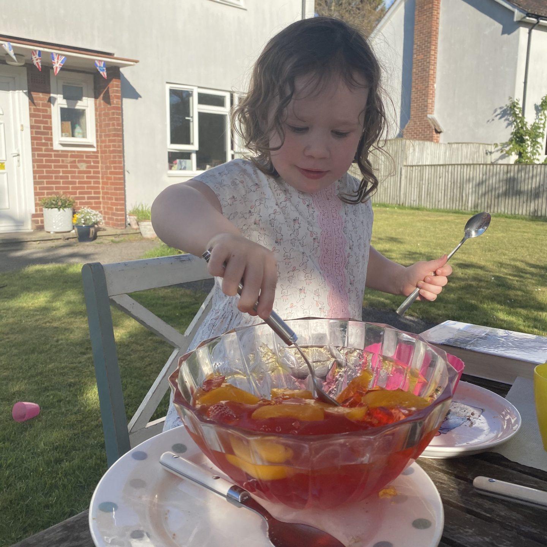 a child enjoying VE Day celebrations eating jelly