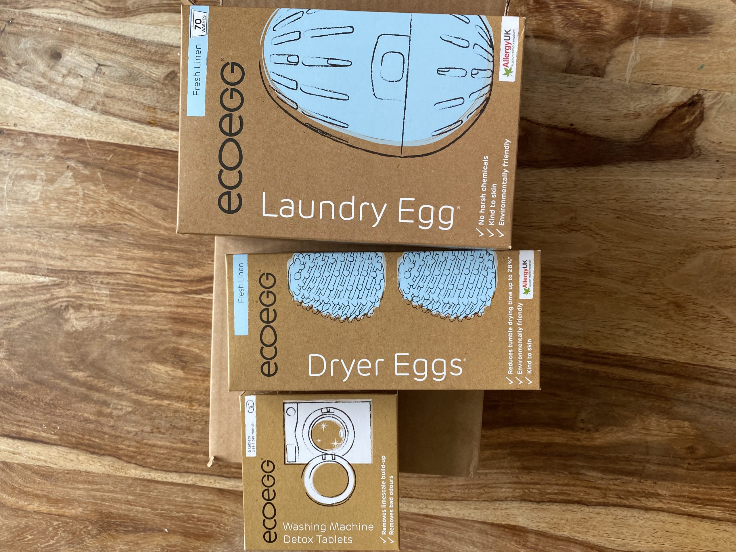 ecoegg review for laundry eggs, dryer eggs and detox tablets all in their packaging on a table.
