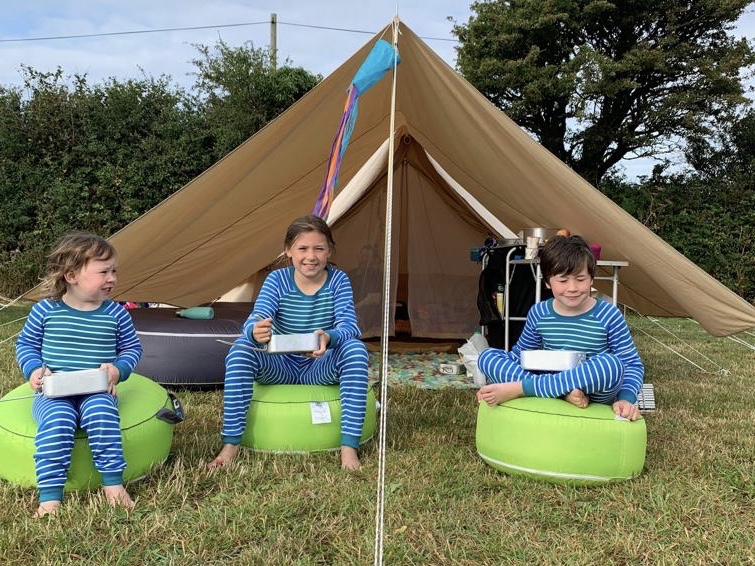 Camping tips and tricks for Families with 3 children outside a bell tent