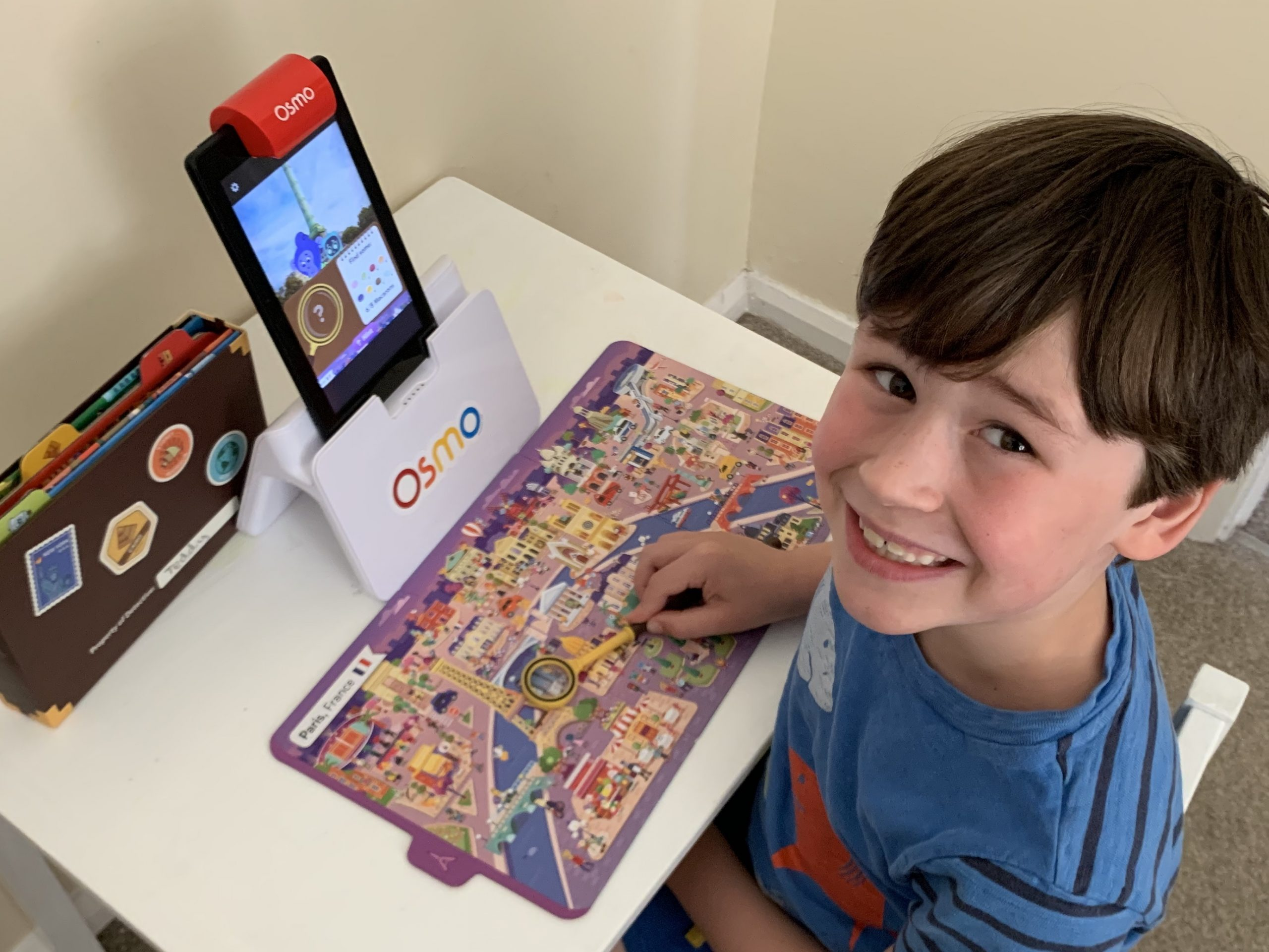 Osmo Review and Osmo detective agency review with a picture of Osmo and a young boy