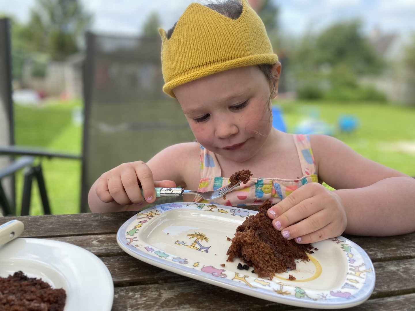 A child enjoying Birthday cake