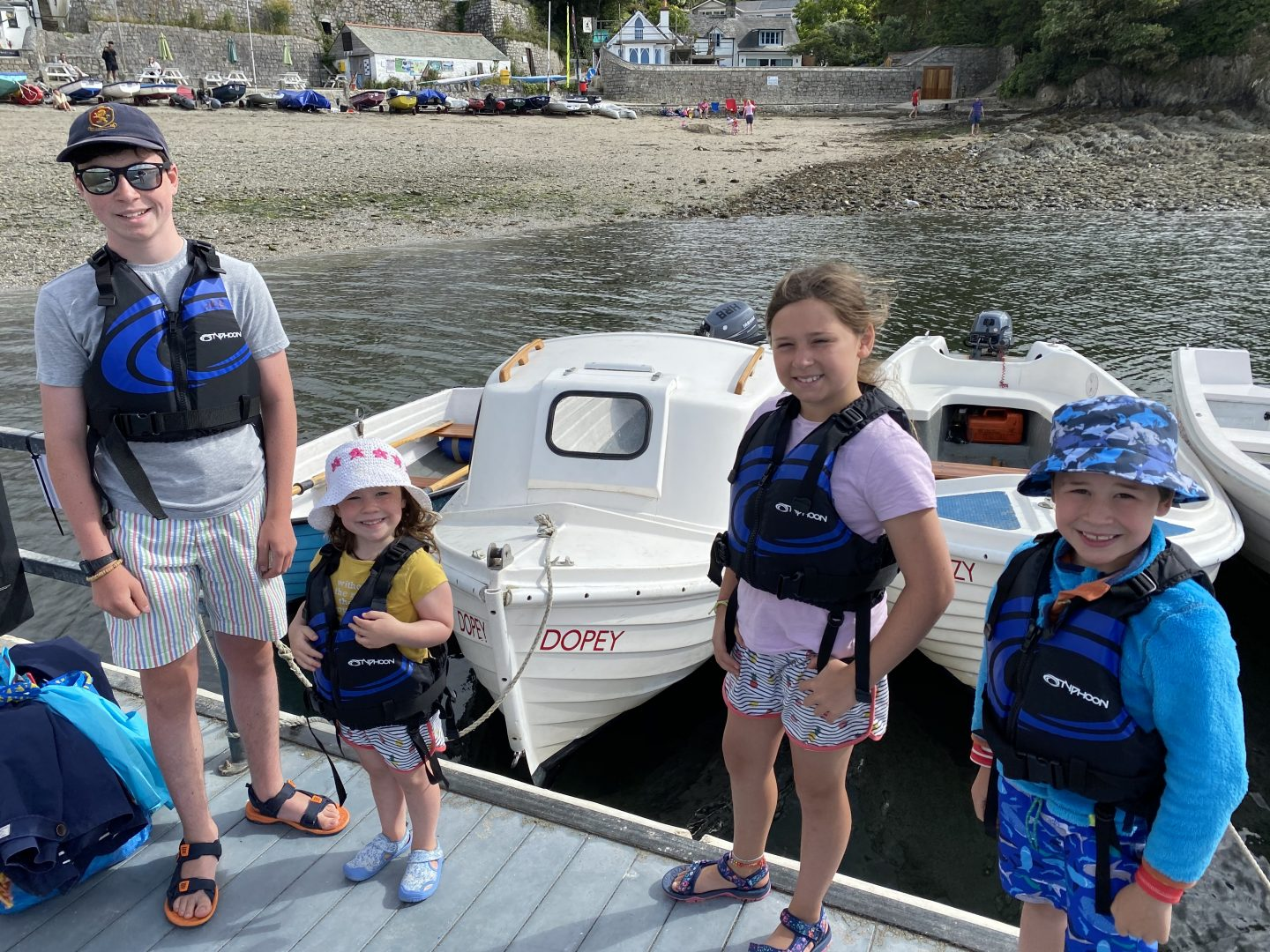 Helford river with 4 children by a motor boat