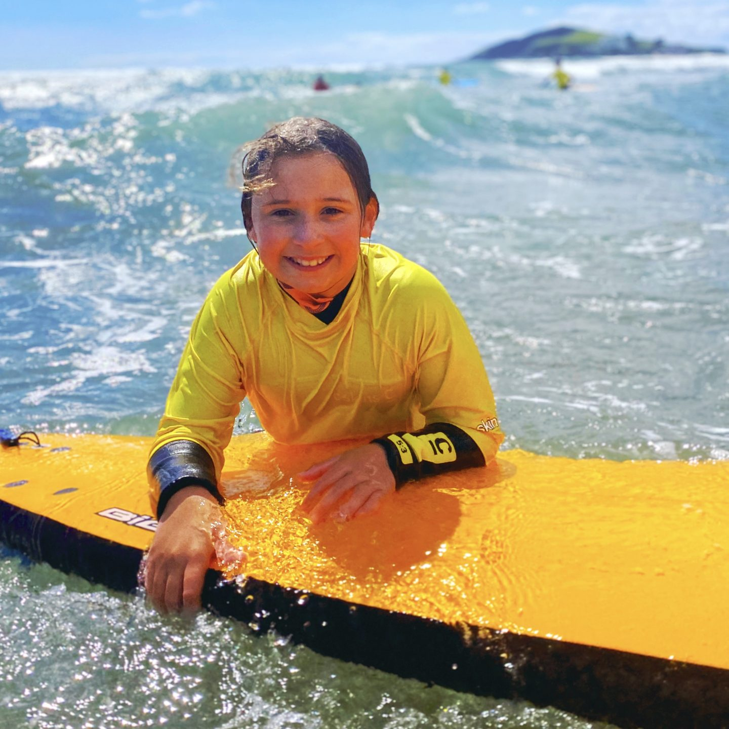 Camping in Devon and a girl surfing at Bantham  beach